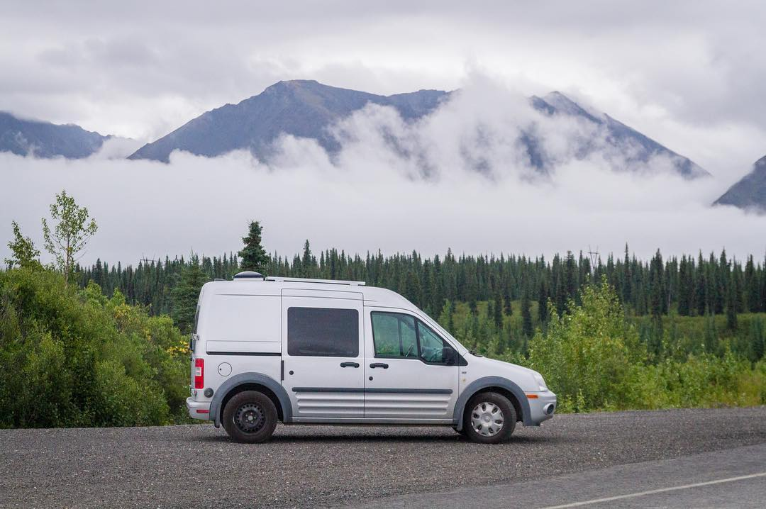 camper van mountains clouds