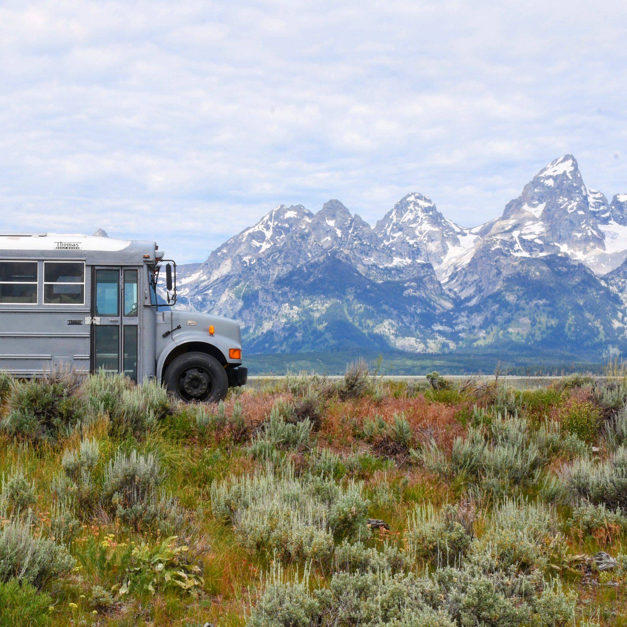 grey bus in mountains