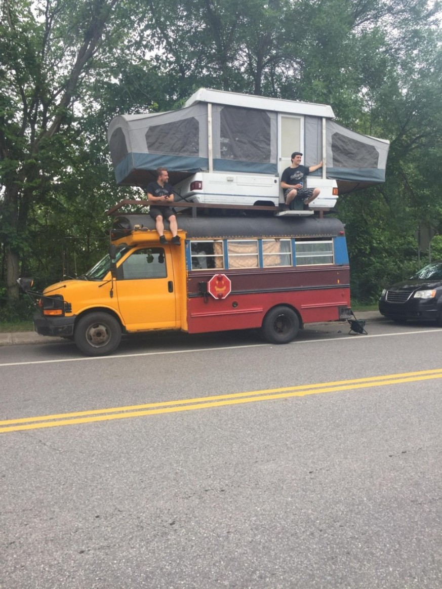 camper on top of short bus