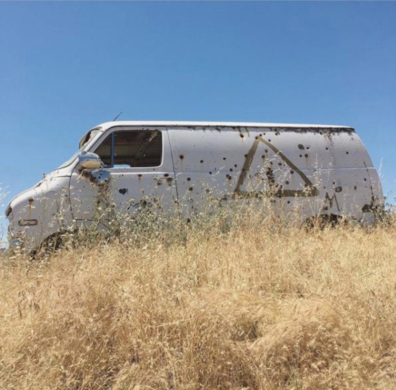 van with bullet holes
