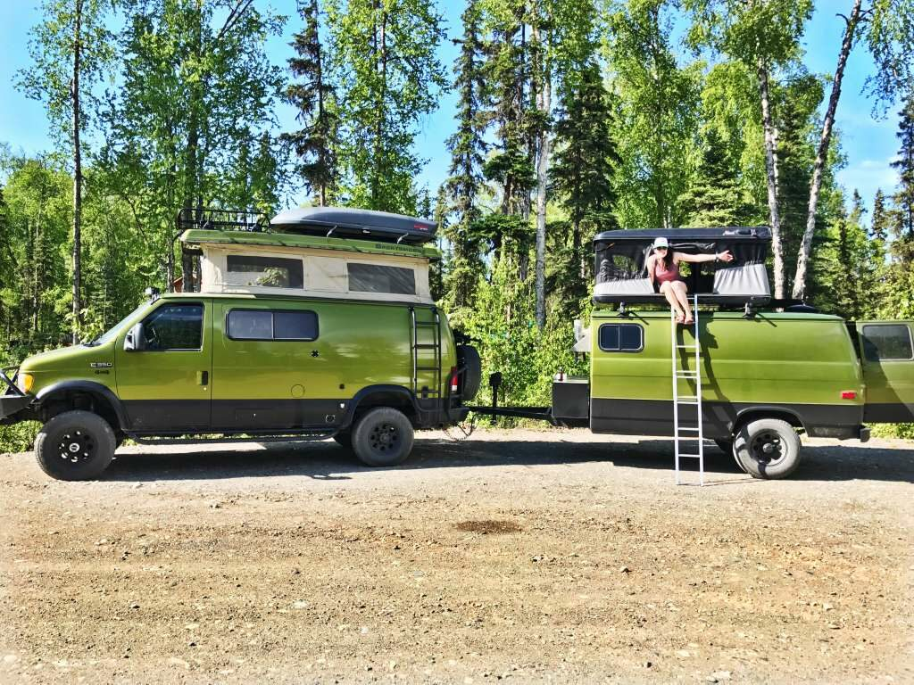 The Ford 350 van converted by Sportsmobile with a towable sauna trailer