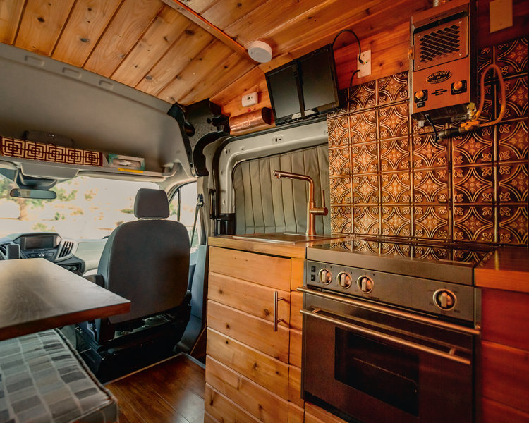 Boho Camper Vans Golden Egg Ford Transit van with foosball table